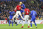 Manchester United Defender Luke Shaw battles in the air and wins a header against Cardiff City defender Callum Paterson (13) during the Premier League match between Cardiff City and Manchester United at the Cardiff City Stadium, Cardiff, Wales on 22 December 2018.