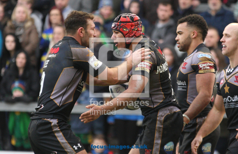 Ben Jones-Bishop (C) of Salford Red Devils celebrates scoring the his first try of the game with his team mates against Warrington Wolves during the First Utility Super League match at the Halliwell Jones Stadium, Warrington<br /> Picture by Stephen Gaunt/Focus Images Ltd +447904 833202<br /> 07/02/2015