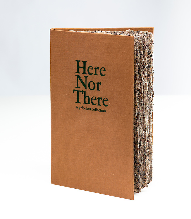 Handmade paper sheets bound into hard bound case. An Artists' Book, titled Here Not There Morgan Hiscocks.