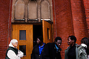 SYRACUSE, NY – DECEMBER 5, 2010: A refugee familiy receives assistance from a Catholic volunteer as they assimilatie into American life.