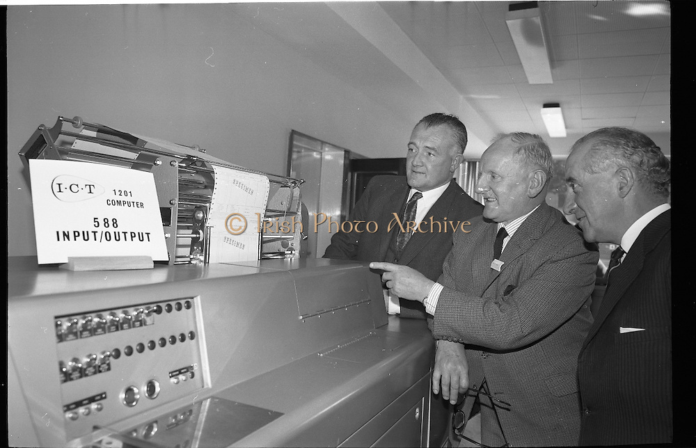 Official Opening of I.C.T.House..1963..01.10.1963..10.01.1963..1st October 1963..Dr James Ryan TD, Minister for Finance,officially opened I.C.T. House ,Adelaide Road, Dublin, for international Computers and Tabulators Ltd. The company had staff working in several sites around the city and the new premises will bring all of them together under the one roof...Management are pictured viewing one of the new computer consoles at the opening of ICT House.