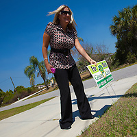 TAMPA, FL -- March 22, 2011 -- Shannon Moore, broker/owner of Green Lion Realty, puts a for sale sign in a home purchased by her investor that morning in North Port, Fla., 2011.  A recent study showed that one and five homes in the state of Florida is vacant.