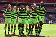 Forest Green Rovers players celebrate Forest Green Rovers Kaiyne Woolery(14) opening goal during the Vanarama National League Play Off Final match between Tranmere Rovers and Forest Green Rovers at Wembley Stadium, London, England on 14 May 2017. Photo by Shane Healey.