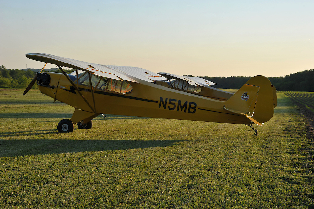 In May of 2012 Kent State Professor Joe Murray flew his Piper Cub airplane for nine days, landing in all 88 counties in Ohio. He was joined by friend Ron Siwik for the whole flight, and by many along the way. This is the night they landed at Graham Farm Airport near Coshocton, Ohio.