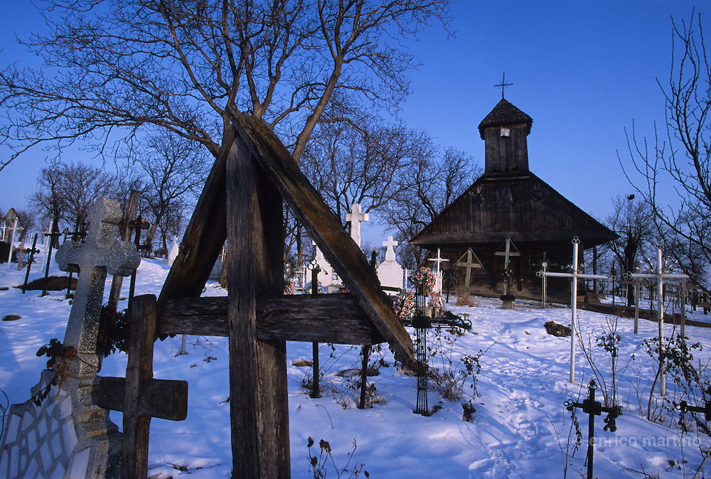 Faraoani village, Forrovalva i Hungarian, the cemetery. In the back the old church, practically the only one traditional csango church surviving today.