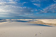 A lone tent in the distance in the backcountry of White Sands National Monument, New Mexico.