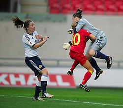 LLANELLI, WALES - Saturday, September 15, 2012: Wales' Sarah Wiltshire clashes with Scotland's goalkeeper Gemma Fay during the UEFA Women's Euro 2013 Qualifying Group 4 match at Parc y Scarlets. (Pic by David Rawcliffe/Propaganda)
