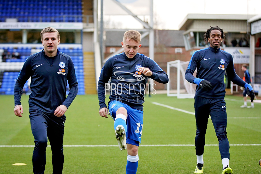 Peterborough Utd midfielder Louis Reed (11), Peterborough Utd forward Ivan Toney (17) and Peterborough Utd forward Jason Cummings (35) warming up before the EFL Sky Bet League 1 match between Peterborough United and Scunthorpe United at London Road, Peterborough, England on 1 January 2019.