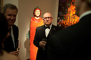 ResMed CEO Peter Farrell, center, chats with Mike Davies, director of the Museum of Contemporary Art San Diego, left, and other guests at the home of Matthew and Iris Strauss in Rancho Santa Fe.