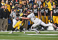 November 21, 2009: Iowa running back Adam Robinson (32) tries to get by Minnesota linebacker Lee Campbell (30) during the first half of the Iowa Hawkeyes 12-0 win over the Minnesota Golden Gophers at Kinnick Stadium in Iowa City, Iowa on November 21, 2009.