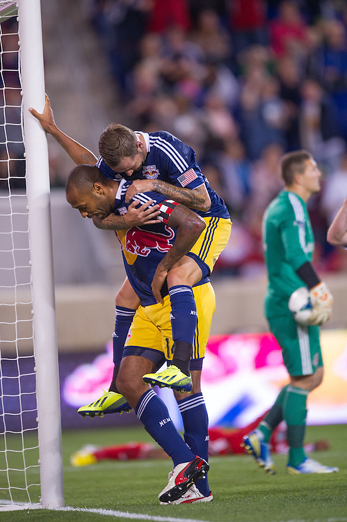 HARRISON, NJ - SEPTEMBER 14:  Thierry Henry #14 of New York Red Bulls leans on the goal after scoring a goal in the first half and Jonny Steele #22 jumps on his back during the game against the Toronto FC at Red Bulls Arena on September 14, 2013. (Photo By: Rob Tringali)