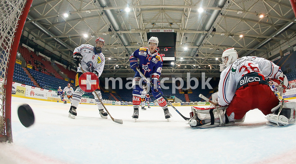 Rapperswil-Jona Lakers goaltender Jeffrey Meier (R) receives his second goal while defenseman Marnik Metting van Rijn (L) and Kloten Flyers forward Thierry Bader (C) look on during a Junior Elite A ice hockey game between Kloten Flyers and Rapperswil-Jona Lakers held at the SWISS Arena in Kloten, Switzerland, Friday, Jan. 29, 2016. (Photo by Patrick B. Kraemer / MAGICPBK)