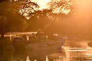 Photo tourists on boats in the Pantanal, Mato Grosso, Brazil