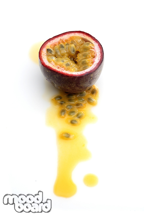 Halved passion fruit on white background