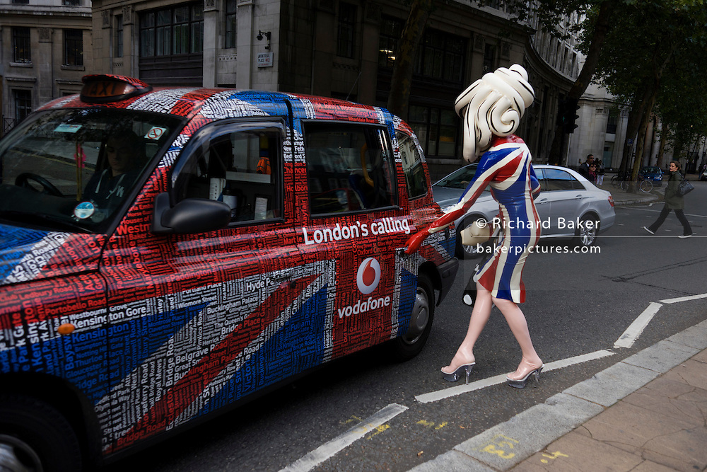 """The character known as Pandemonia, part-parody, living sculpture and fine artist leaves a London fashion show in a London taxi cab during Fashion Week. Writing about herself at www.pandemonia99.com she writes that she is """"a 7ft tall personality often seen at exclusive premiers, events and exhibitions. Post pop, conceptual artist, written about in iD, independent and Vogue publications."""" Otherwise, few have any idea about who or what this cartoon character is, or even how this creature secures an invite to parties, society and art events. The writer Poonperm Paitayawat says """".. She is about branding, self-image and lifestyle. She is tapping into the collective unconsciousness. Pandemonia goes beyond pop art."""""""