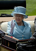 © Licensed to London News Pictures. 19/06/2012. Ascot, UK  HRH Queen Elizabeth II. The Royal Procession enter the parade ring on Day one at Royal Ascot 19 June 2012. Royal Ascot has established itself as a national institution and the centrepiece of the British social calendar as well as being a stage for the best racehorses in the world.. Photo credit : Stephen Simpson/LNP