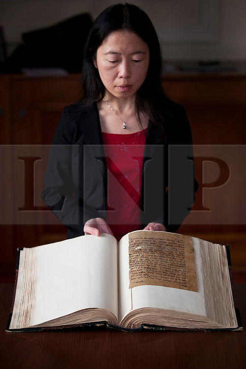 © Licensed to London News Pictures. 06/02/2013. London, UK. Lucy Cheng, a book and paper conservator from Cambridge University, holds up a copy of the a letter from a Jewish woman asking her husband to return home (he did not want to live with his in-laws) (thought to date from around 12th-14th century) part of the Lewis-Gibson Genizah Collection, at the British Academy in London today (06/02/2013). Oxford and Cambridge Universities today launched their first ever joint fundraising campaign to acquire the £1.2 million Lewis-Gibson Genizah Collection. The collection comprises more than 1,700 fragments of Hebrew and Arabic manuscripts, originating from the Cairo Genizah and dating from the 9th-19th century. Photo credit: Matt Cetti-Roberts/LNP