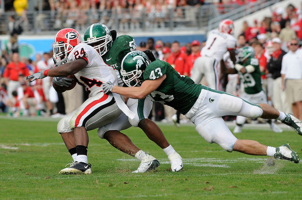 January 1, 2009: Knowshon Moreno of the Georgia Bulldogs is tackled by Eric Gordon of the Michigan State Spartans during the NCAA football game between the Michigan State Spartans and the Georgia Bulldogs in the Capital One Bowl. The Bulldogs defeated the Spartans 24-12.