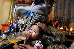 Mongolian Shaman Batgerel Batmunkh (back) while possessed by the white spirit kisses his niece Munkhsoyol during a Shaman healing ritual in their ger on the outskirts of Ulan Bator, Mongolia, 04 July Mongolian brothers Gankhuyag and Batgerel Batmunkh share a similar fate. Both were construction workers before fate calls on them to take on their Shamanic roles to serve the spirits. Shamanism comes from the term 'shamans' that refers to priests or mediums that acts as vessels for spirits, gods and demons to communicate with the human world. In Mongolia, they adhere to the ancient beliefs of Tengrism, where spirits live in all of nature, in the sun, moon, lakes, rivers, mountains, and trees.2012.