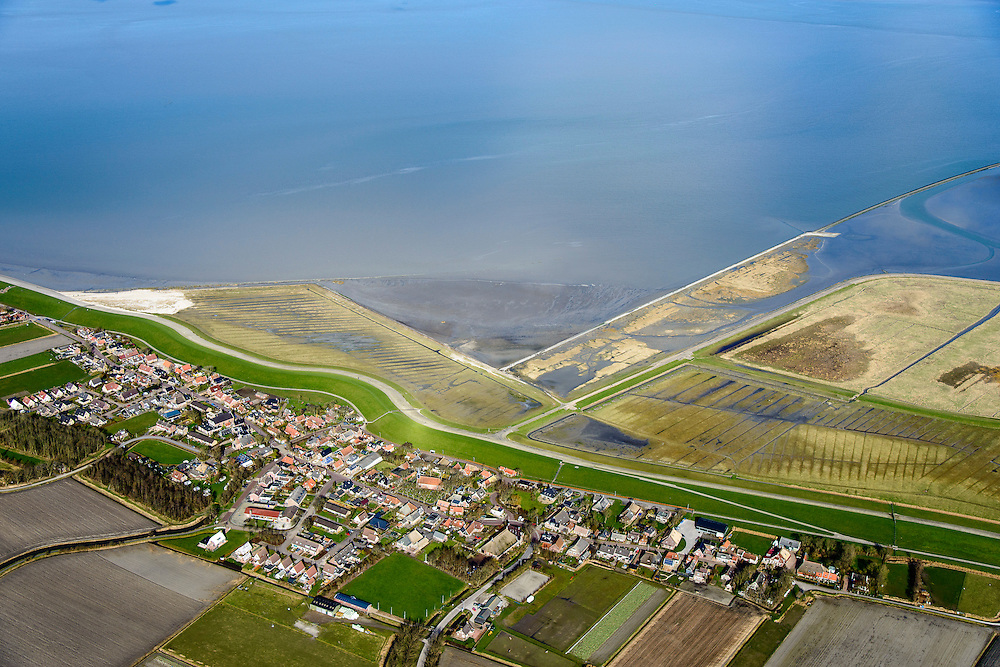 Nederland, Friesland, Gemeente Dongeradeel, 28-02-2016; Paesens-Moddergat, twee dorpen gelegen aan de Waddenkust, achter de zeedijk van de Waddenzee. In de achtergrond de Waddenzee.<br /> Twin villages located on the Wadden Sea, behind the dike of the Wadden Sea.<br />  <br /> luchtfoto (toeslag op standard tarieven);<br /> aerial photo (additional fee required);<br /> copyright foto/photo Siebe Swart
