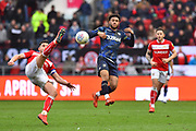 Tyler Roberts (11) of Leeds United watches Bailey Wright (5) of Bristol City gets to the ball first during the EFL Sky Bet Championship match between Bristol City and Leeds United at Ashton Gate, Bristol, England on 9 March 2019.