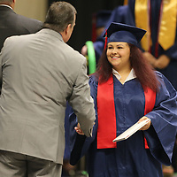 Ebony Fields walks across the stage after receiving her diploma during the Nettleton High School graduation Saturday.