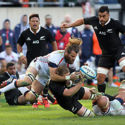 USA Captain Todd Clever defends his Eagles try line in the 2nd half.  The legendary New Zealand All Blacks defeated the USA Eagles 74-6 at Soldier Field, Chicago, Illinois, USA.  Photo by Barry Markowitz, 11/1/14, 3pm
