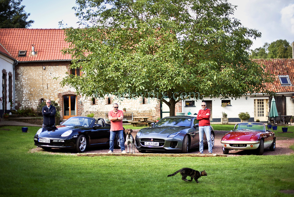 05 Sept 2019. St Denoeux, Pas de Calais, France.<br /> Messing about with cars. With Rob, Chris and Simon with their cars, the Porsche Boxter, Jaguar F Type and Lotus Elan Sprint at Festina Lente Gîtes. Donut the dog puts in a modelling appearance as Coco the cat photobombs the scene.<br /> Photo©; Charlie Varley/varleypix.com
