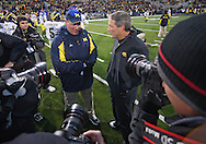 October 10, 2009: Iowa head coach Kirk Ferentz and Michigan head coach Rich Rodriguez talk before the Iowa Hawkeyes' 30-28 win over the Michigan Wolverine's at Kinnick Stadium in Iowa City, Iowa on October 10, 2009.