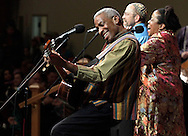 Reggie Harris plays the guitar as Kim Harris and Rabbi Jonathan Kligler, rear, sing during a benefit concert for Save Them Now at the Pointe of Praise Family Life Center in Kingston on Monday, Jan. 18, 2010. Save Them Now is a re-entry program for men returning to Ulster County from incarceration or long-term drug treatment programs.
