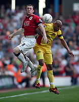 Photo: Paul Thomas.<br /> Watford v Manchester United. The FA Cup, Semi Final. 14/04/2007.<br /> <br /> Wayne Rooney (L) of Utd wins the ball and gets past Jordan Stewart to run in and set up Cristiano Ronaldo's goal.