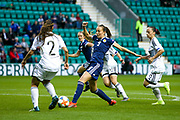 Caroline Weir (#9) of Scotland attempts to get away a shot through a crowd of Cyprus defenders during the Women's Euro Qualifiers match between Scotland Women and Cyprus Women at Easter Road, Edinburgh, Scotland on 30 August 2019.