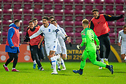 Dimitrios Nikolaou (#4) of Greece U21 runs away to celebrate after scoring a penalty goal during the U21 UEFA EUROPEAN CHAMPIONSHIPS match between U21 Scotland and U21 Greece at Tynecastle Park, Edinburgh, Scotland on 15 November 2019.