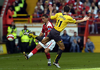 Photo: Olly Greenwood.<br />Charlton Athletic v Arsenal. The Barclays Premiership. 30/09/2006. Charlton's Luke Young and Arsenal's Robin van Persie