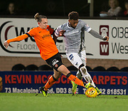12th January 2019, Tannadice Park, Dundee, Scotland; Scottish Championship football, Dundee United versus Dunfermline Athletic; Myles Hippolyte of Dunfermline Athletic challenges for the ball with Aiden Nesbitt of Dundee United