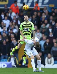 Yeovil Town's Shane Duffy wins an aerial ball against Leeds United's Matt Smith-Photo mandatory by-line: Matt Bunn/JMP - Tel: Mobile: 07966 386802 02/11/2013 - SPORT - FOOTBALL - Elland Road - Leeds - Leeds United v Yeovil Town - Sky Bet Championship