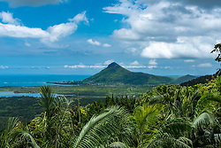 Lokking over Mauritius from Chamarel, a muntain rises in the distance