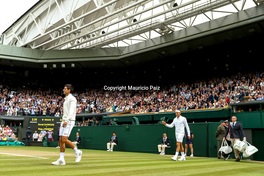 LONDON, ENGLAND - JULY 6: Novak Djokovic of Serbia and Roger Federer of Switzerland enter centre court during the Gentlemens' Singles final match on day thirteen of the Wimbledon Lawn Tennis Championships at the All England Lawn Tennis and Croquet Club at Wimbledon on July 6, 2014 in London, England.