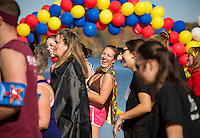 """Amy Beaudoin from the """"Super Heroes Team"""" gets warmed up dancing in the crowd just prior to taking the Turkey Plunge in Lake Opechee on Saturday afternoon.  (Karen Bobotas/for the Laconia Daily Sun)"""