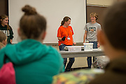 Nelsonville-York Elementary School fifth grade science teacher Olivia Kittle (Center) performs a science experiment for her students with the help of Ohio University meteorology students during a visit to the Athens Campus. Photo by Ben Siegel