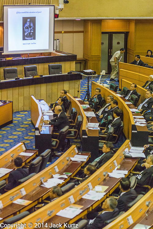 21 AUGUST 2014 - BANGKOK, THAILAND:    A photograph of Gen Prayuth Chan-ocha, the only candidate for Prime Minister is projected in the chambers while the Thai National Legislative Assembly (NLA) meets in the parliament to select a new Prime Minster. The NLA was hand selected by the Thai junta, formally called the National Council for Peace and Order (NCPO), and is supposed to guide Thailand back to civilian rule after a military coup overthrew the elected government in May. The NLA unanimously selected General Prayuth Chan-ocha, commander of the Thai Armed Forces and leader of the coup in May that deposed the elected civilian government, as Prime Minister. Prayuth is Thailand's 29th Prime Minister since the 1932 coup that created Thailand's constitutional monarchy.    PHOTO BY JACK KURTZ