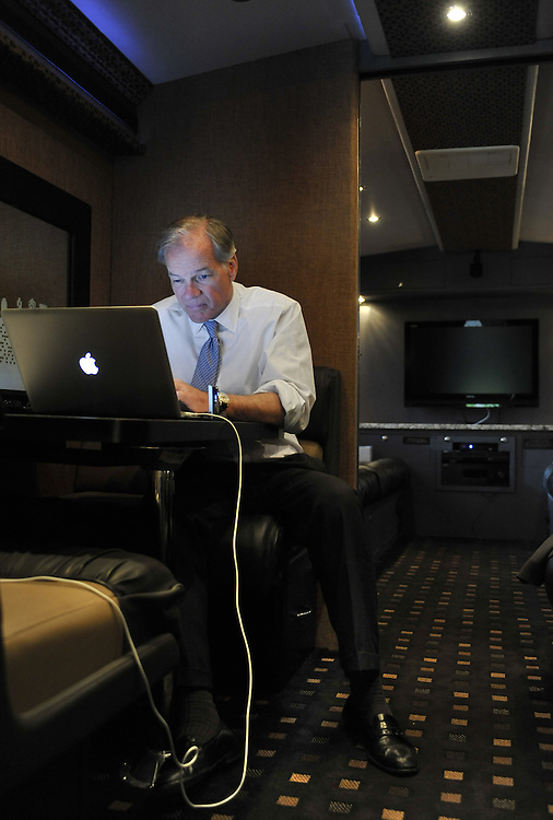 In this Oct. 18, 2010 photo, Republican candidate for governor Tom Foley works on his laptop computer inside his campaign bus in New Haven, Conn. (AP Photo/Jessica Hill)