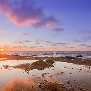 Sunset Atlantic Ocean view at Dar Bouazza rocky beach, in Casablanca south coast. Morocco.
