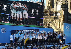 Manchester City celebrate onstage during the trophy parade in Manchester.
