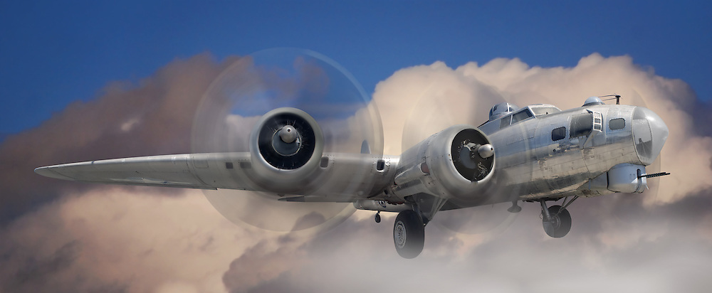 Fish eye view of a B-17 Stratofortress airplane in the clouds