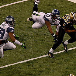 November 21, 2010; New Orleans, LA, USA;  New Orleans Saints wide receiver Robert Meachem (17) breaks away from Seattle Seahawks linebacker David Hawthorne (57) during the first quarter at the Louisiana Superdome. The Saints defeated the Seahawks 34-19. Mandatory Credit: Derick E. Hingle
