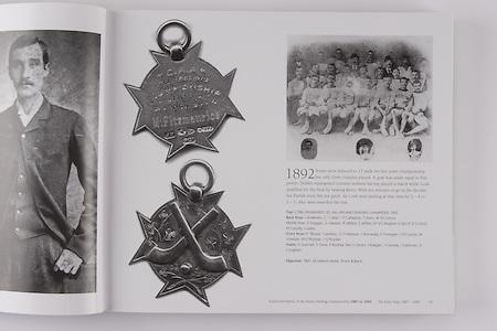 "Top: Cork (Redmonds Sel) All- Ireland Hurling Champions 1892. Back Row: J Anderson, C ""Callan"" O'Callaghan, T Irwin, W O'Connor. Middle Row: D Duggan, G Gleeson, R Millard, E Jeffers, W O'Callaghan ( capt), E O'Connor, M Cassidy, J Leahy. Front Row: P ""Bossie"" Cantillon, D O'Halloran, J Kenneally, D Finnegan, J O'Connor, M Sheehan, M O'Riordan, J O'Riordan. Insets: D Scannell, D Drew, P Buckley. Not in photo: J Keegan, J Conway, J Cashman, D Coughlan. .Opposite: 1891 All-Ireland medal."