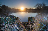 A winter dawn over one of the small ponds found on Cow Common, Chilbolton, Hampshire