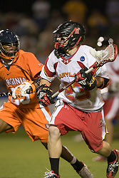 Maryland midfielder Tony Mendes (23) is defended by Virginia midfielder Will Barrow (23).  The #3 ranked Virginia Cavaliers defeated the #8 ranked Maryland Terrapins 11-8 in the semi finals of the Men's 2008 Atlantic Coast Conference tournament at the University of Virginia's Klockner Stadium in Charlottesville, VA on April 25, 2008.