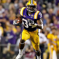 November 13, 2010; Baton Rouge, LA, USA; LSU Tigers running back Stevan Ridley (34) runs with the ball during the first half against the Louisiana Monroe Warhawks at Tiger Stadium.  Mandatory Credit: Derick E. Hingle